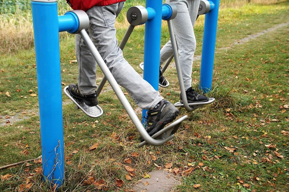 Two seniors working out in the park
