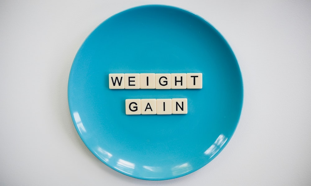 Weight gain spelled out on a blue plate